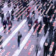 Stream of people walking down a street with an overlay of a data matrix